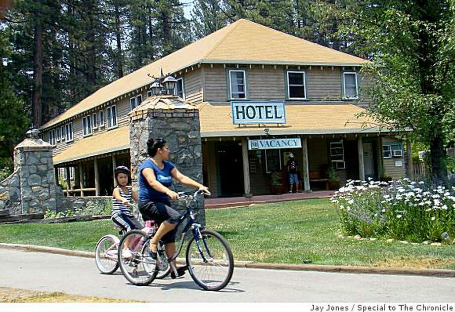Cyclists enjoy the bike path that winds through the forest after passing in front of the hotel at Camp Richardson. Photo: Jay Jones, Special To The Chronicle