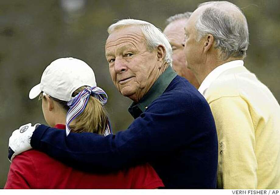 Arnold Palmer greets his junior playing partner, Lisa Chandler, at Del Monte GC on Friday. Photo: VERN FISHER, AP
