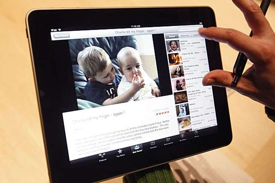 FILE - In this Jan. 27, 2010 file photo, the Apple iPad is examined after its unveiling at the Moscone Center in San Francisco. Apple said Friday, March 5,  its much-anticipated iPad tablet will hit U.S. store shelves on April 3. Photo: Marcio Jose Sanchez, AP