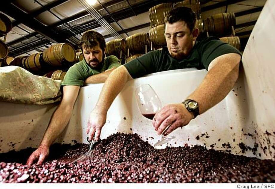 Wine section cover story on winemakers in Santa Barbara County. Photo of McPrice Myers (right) and Russell From (left), both young guys making wine separately as McPrice Myers Wine Co. and Herman Story Wines in Santa Maria. They both make a wine together called Barrel 27. Photo of them checking out some of their Grenache grapes. Photo: Craig Lee, SFC