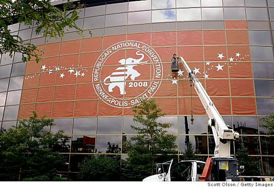 ST. PAUL, MN - AUGUST 27:  Roger Leary hangs a Republican National Convention banner outside the Xcel  Energy Center August 27, 2008 in St. Paul, Minnesota. St. Paul will host the convention which runs September 1-4. (Photo by Scott Olson/Getty Images) Photo: Getty Images