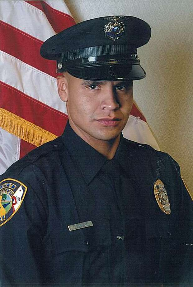 File - This undated file picture provided on Feb. 26, 2010, by the Reedley, Calif. Police Department via The Fresno Bee shows police officer Javier Bejar.  Bejar, who was critically wounded in a rural Fresno County shootout on Feb. 25 that left two othersdead, was taken off life support Monday, March 1, 2010. Bejar, who survived a tour of Iraq as a Marine, is the first Reedley officer to die in the line of duty in the department's 100-year history. Photo: Reedley Police Dept., AP