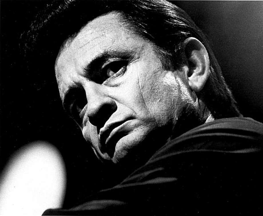**FILE** In this 1969 file photo, country singer Johnny Cash is photographed at an unknown location. A concert marking the 40th anniversary of Cash's famous concert at Folsom State Prison scheduled for Sunday, Jan. 13, 2008, has been scraped, with the prison and the promoter blaming each other for the cancellation.  (AP Photo, file) Photo: File, 1969, AP