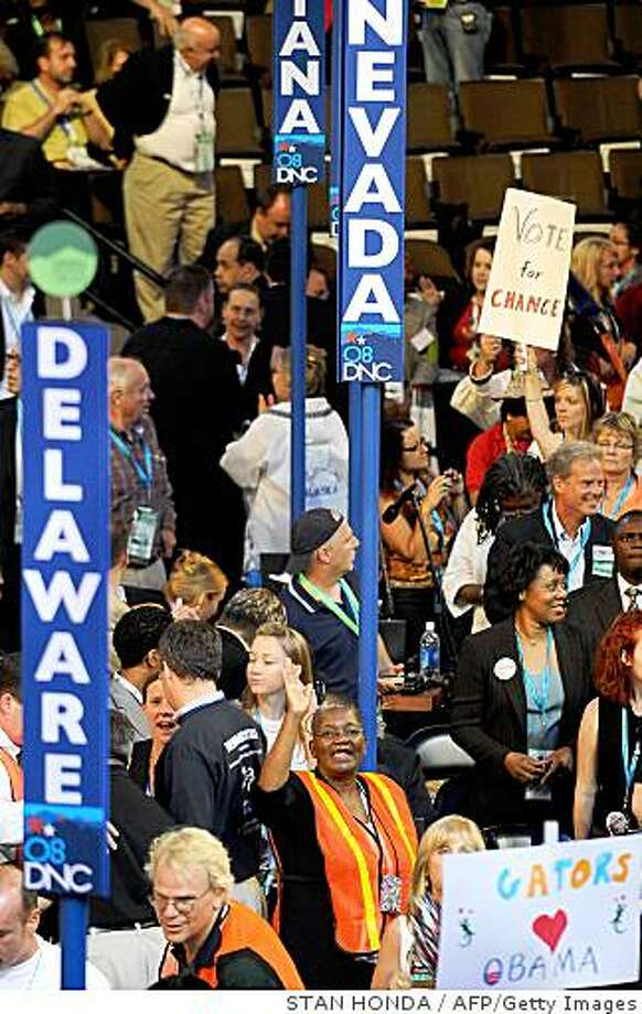 Delegation members crowd the floor of the Democratic National Convention 2008 at the Pepsi Center in Denver on August 26, 2008. Hillary Clinton takes center stage tonight vowing to unite Democrats after her primary battle with Barack Obama, on the second day of the convention that will crown him as White House nominee on August 28.            AFP PHOTO/Stan HONDA (Photo credit should read STAN HONDA/AFP/Getty Images) Photo: STAN HONDA, AFP/Getty Images
