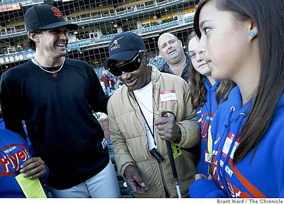 Barry Zito talked with Earnest Jeffers, center, a veteran while members of the Flyers team from Fremont listened. Barry Zito greeted a group of high school soft ball players from Fremont and some wounded veterans before the Giants game Monday August 25, 2008. Photo: Brant Ward, The Chronicle