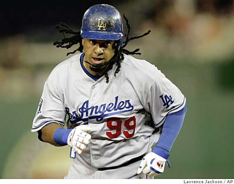 Los Angeles Dodgers' Manny Ramirez runs toward third base  on a single by James Loney in the sixth inning of a baseball game against the Washington Nationals on Tuesday, Aug. 26, 2008, in Washington. The Nationals won 2-1. (AP Photo/Lawrence Jackson) Photo: Lawrence Jackson, AP