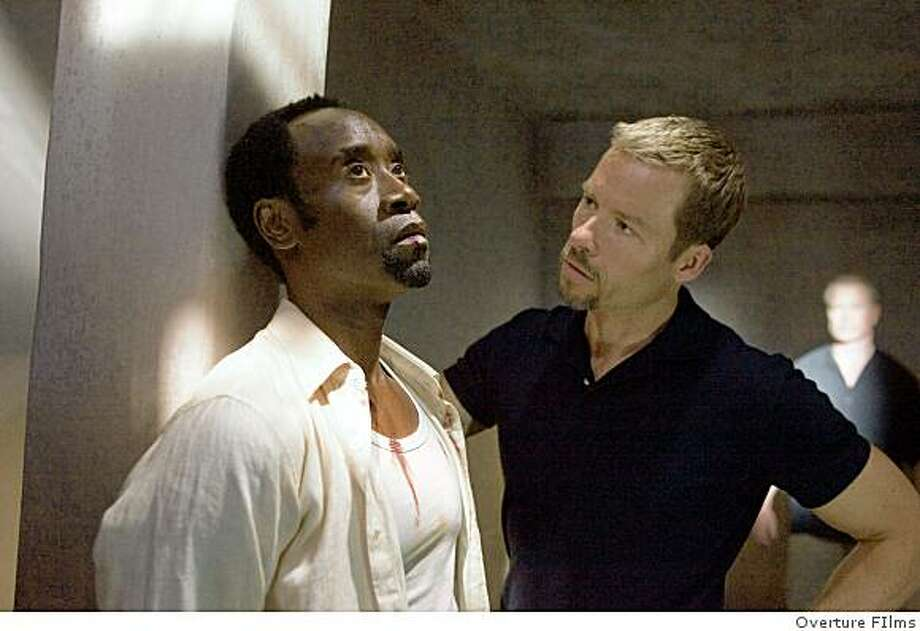 (Left to right.) Don Cheadle and Guy Pearce star in Overture Films' Traitor. Photo: Overture FIlms
