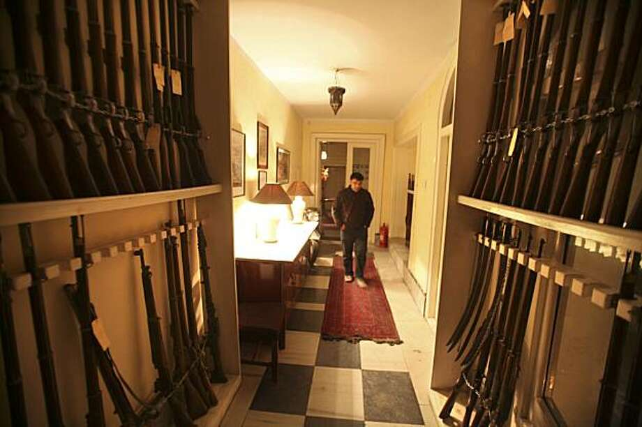 This Jan. 30, 2010 photo shows antique rifles on display inside the Gandamack Lodge in Kabul, Afghanistan. The lodge was inspired by Brig. Gen. Sir Harry Paget Flashman, the fictional antihero of a dozen popular historical novels by George Macdonald Fraser and is an eccentric piece of work, a resurrection of Victorian England in a walled compound bristling with security guards in an Afghan capital whose streets can quickly turn deadly. Photo: Altaf Qadri, AP