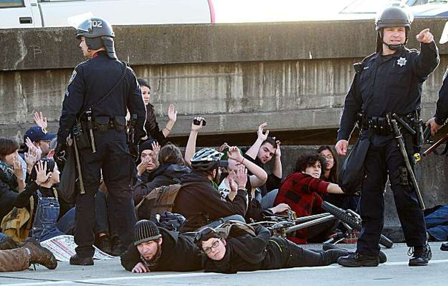 OAKLAND, CA - MARCH 04:  Oakland police officers arrest a group of protestors that attempted to block Interstate 880 following a rally for the national day of action against school funding cuts and tuition increases March 4, 2010 in Oakland, California. Dozens of protestors were arrested after they stormed the 880 freeway as students across the country are walking out of classes and holding demonstrations against massive tuition increases and funding cuts to college universities. Photo: Justin Sullivan, Getty Images