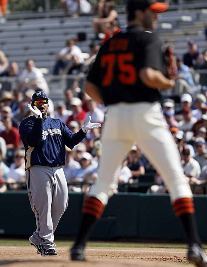 Milwaukee Brewers' Prince Fielder, left, claps at first base while looking toward San Francisco Giants starting pitcher Barry Zito, right, during the first inning of their spring training baseball game in Scottsdale, Ariz., Thursday, March 4, 2010. Fielder was hit on the first pitch thrown to him by Zito. Photo: Eric Risberg, AP