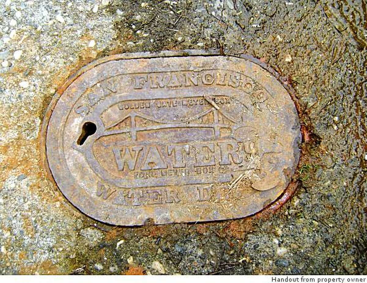 Rusty water cover from 740-24th Avenue in S.F.