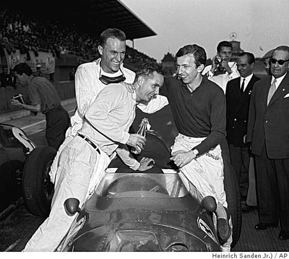 The Grand Prix of Germany for Formula I cars was held on August 2, 1959 on West Berlin's Avus Track. Left to right after the race: Phil Hill, Santa Monica, California, third place; Dan Gurney, Riverside, California, second place, and Tony Brooks, Britain, the winner. (AP Photo/Heinrich Sanden Jr.) Photo: Heinrich Sanden Jr., AP