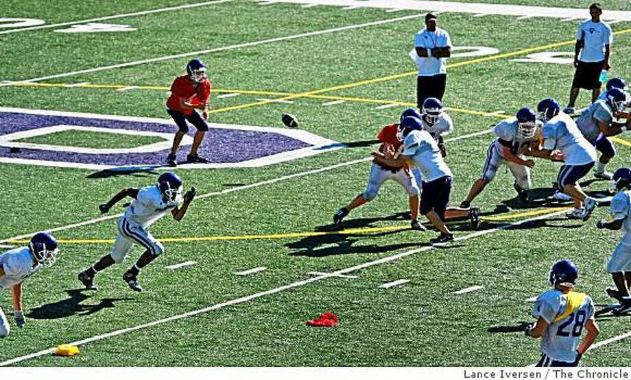 "Piedmont High School Varsity Quarterback Jeremy George takes a snap as the football team runs the new offense ""The A-11 Offense"" which opens up the game making all 11 players eligible receivers. Photographed Wednesday, August 27, 2008, in Piedmont Photo: Lance Iversen, The Chronicle"