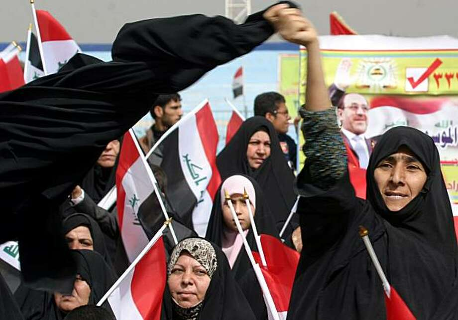 A female supporter of Iraqi Prime Minister Nouri al-Maliki is seen at an election rally in the Shiite city of Najaf, 160 kilometers (100 miles) south of Baghdad, Iraq, Saturday, Feb. 27, 2010. Iraq's national election is set for March 7. Photo: Alaa Al-marjani, AP