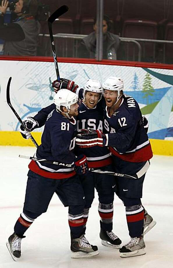 Phil Kessel, Joe Pavelski and Ryan Malone of the United States celebrate Malone's first period goal against Finland in a semifinal hockey game at the Winter Olympic Games in Vancouver, British Columbia, on Friday. Photo: Paul Chinn, The Chronicle