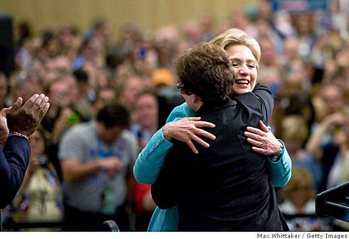 DENVER- AUGUST 27: U.S. Sen. Hillary Clinton (D-NY) (R) hugs a woman from Texas while meeting with her delegates during day three of the 2008 Democratic National Convention at the Pepsi Center August 27, 2008 in Denver, Colorado. U.S. Sen. Barack Obama (D-IL) will be officially be nominated as the Democratic candidate for U.S. president on the last day of the four-day convention at the Pepsi Center. (Photo by Max Whittaker/Getty Images)