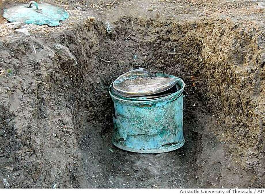 In this hand out image provided by Aristotle University of Thessaloniki on Friday. Aug. 29, 2008, a 2,300-year-old copper vat that contained a gold jar in which archaeologists found a gold wreath and human bones is seen. Archaeologists say the discovery, at the ancient city of Aigai in northern Greece, is very important due to the richness of the artifacts and the unusual circumstances in which they were buried. The finds appear to have been removed from a grave and concealed under the marketplace of Aigai, the heart of the ancient city. Photo: Aristotle University Of Thessalo, AP