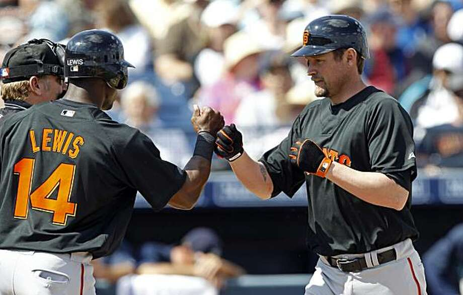San Francisco Giants' Aubrey Huff, right, is greeted by teammate Fred Lewis after his first-inning home run against the Seattle Mariners in a spring training baseball game Wednesday, March 3, 2010, in Peoria, Ariz. Photo: Charlie Neibergall, AP