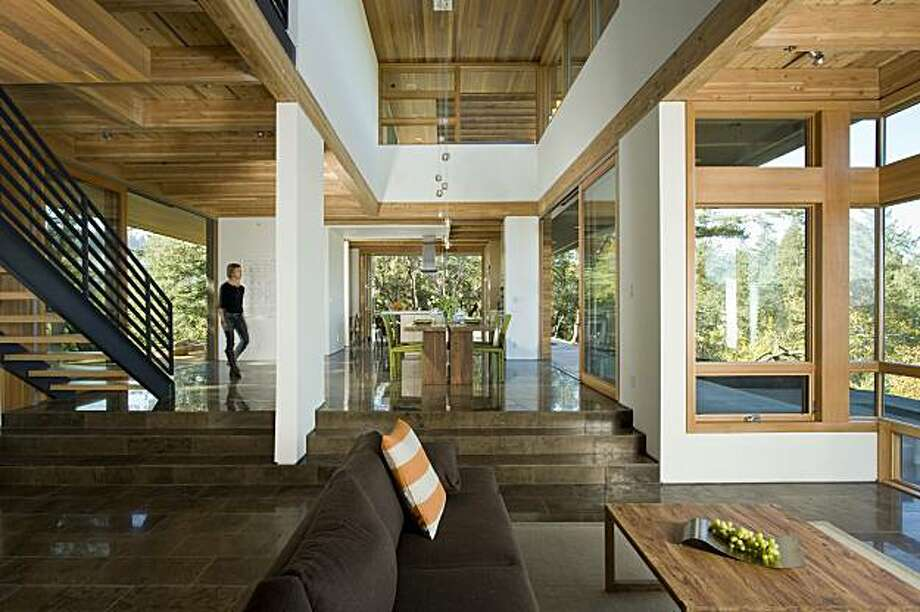Leigh Hudson in the light and airy interior of the sustainable home designed for her family by Emeryville architect Robert Swatt. Large expanses of sliding doors exploit the dramatic views and natural ventilation. Photo: Russell Abraham