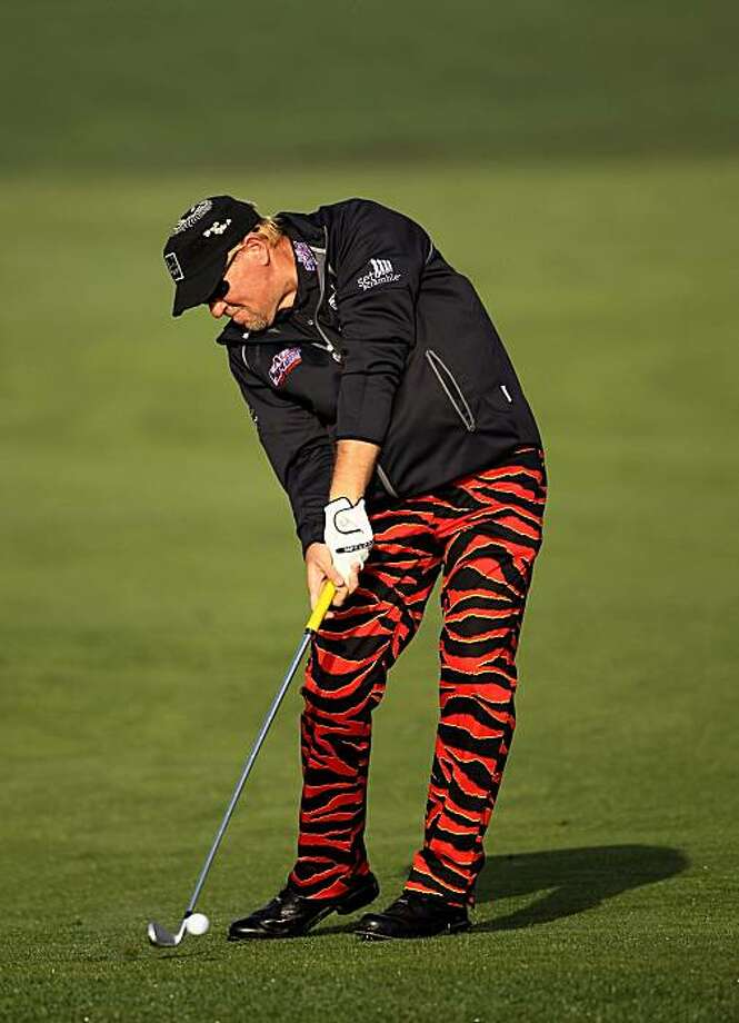 PEBBLE BEACH, CA - FEBRUARY 13:  John Daly hits his approach shot on the second hole during round three of the AT&T Pebble Beach National Pro-Am at Pebble Beach Golf Links on February 13, 2010 in Pebble Beach, California. Photo: Ezra Shaw, Getty Images