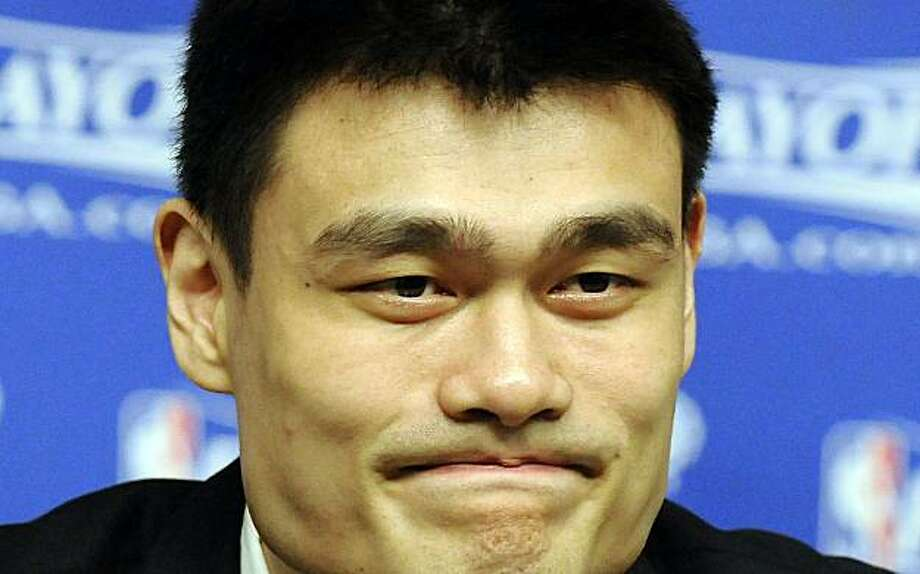 FILE - This May 10, 2009, file photo shows Houston Rockets' Yao Ming pausing during a news conference before Game 4 of a second round Western Conference NBA playoff basketball game against the Los Angeles Lakers, in Houston. Chinese basketball fans want to know _ will Yao Ming's baby be an American? The Houston Rockets center recently returned to the United States with wife Ye Li. That prompted speculation among his followers that the baby girl due this summer could be born in America. Photo: Pat Sullivan, AP