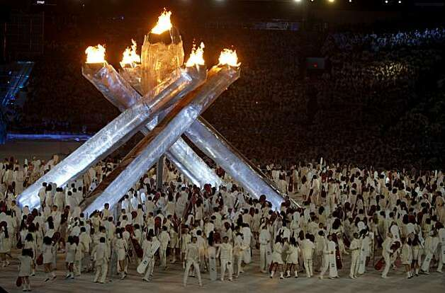 Performers with snowboard props dance under the Olympic Flame during the Closing Ceremonies of the Winter Olympic Games in Vancouver, British Columbia, on Sunday, Feb. 28, 2010. Photo: Paul Chinn, The Chronicle