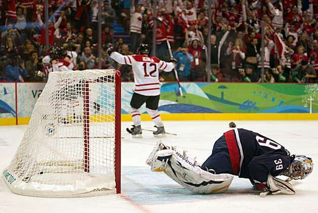 USA goalie Ryan Miller collapses to the ice as Canada players celebrate after Sidney Crosby celebrates after scoring the game-winner over the USA during the overtime period in the men's ice hockey gold medal game at the 2010 Winter Olympics on Sunday, Feb. 28, 2010, in Vancouver. Canada won the game 3-2 on a goal by Canada's Sidney Crosby. ( Smiley N. Pool / Houston Chronicle) Photo: Smiley N. Pool, Chronicle Olympic Bureau