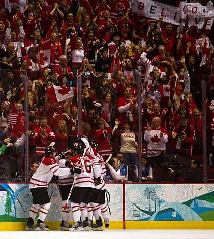 Canada players celebrate a goal during the first period in the men's ice hockey gold medal game at the 2010 Winter Olympics on Sunday, Feb. 28, 2010, in Vancouver. ( Smiley N. Pool / Houston Chronicle) Photo: Smiley N. Pool, Chronicle Olympic Bureau