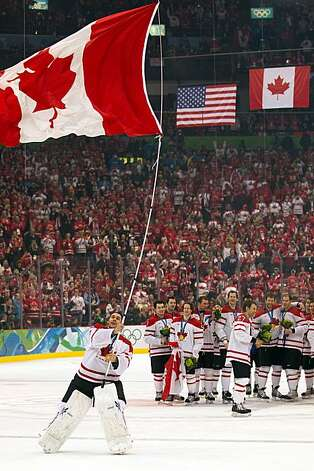 Canada goalie Roberto Luongo waves a Canadian flag following the men's ice hockey gold medal game at the 2010 Winter Olympics on Sunday, Feb. 28, 2010, in Vancouver. Canada won the game 3-2 on a goal by Sidney Crosby. ( Smiley N. Pool / Houston Chronicle) Photo: Smiley N. Pool, Chronicle Olympic Bureau