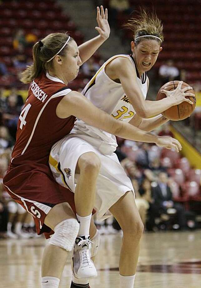 Stanford' Kayla Pedersen, left, pressures Arizona State's Becca Tobin (32) during the second half of an NCAA college basketball game Thursday, Feb. 25, 2010, in Tempe, Ariz.  Stanford defeated Arizona State 62-43. Photo: Ross D. Franklin, AP