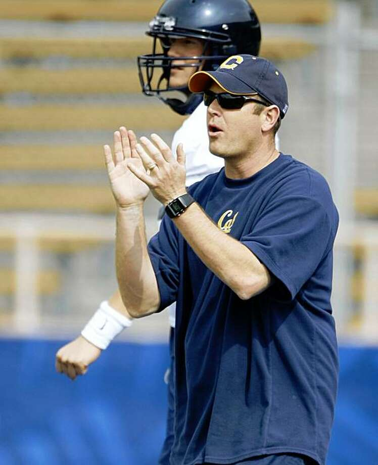 Cal football offensive coordinator Frank Cignetti works at a team practice at Memorial Stadium on the UC Berkeley (Calif.) campus on April 2, 2008. Quarterback Kevin Riley (13) Cal football quarterback Nate Longshore (6) Cal football defensive lineman Derrick Hill (76) Cal football wide receiver Michael Calvin (84) Cal football wide receiver Jeremy Ross (3)  Cal football wide receiver Nyan Boateng (8) Cal football head coach coach Jeff Tedford   Photo by Michael Maloney / San Francisco Chronicle Photo: Michael Maloney, The Chronicle