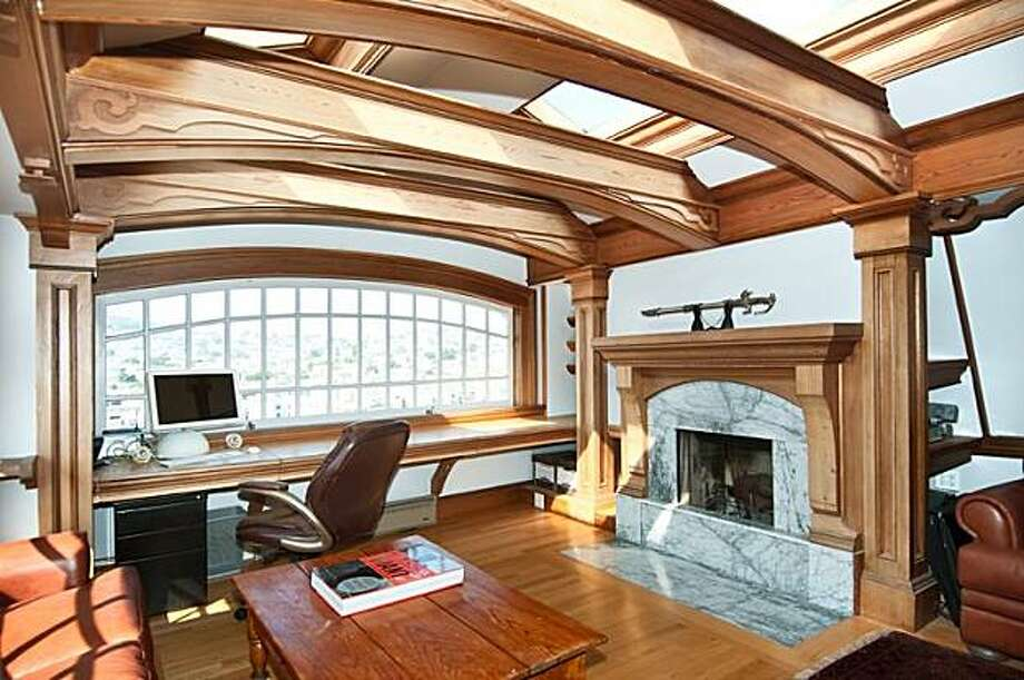 The media room in this four level Victorian in Bernal Heights that is on the market for $1.495 million. Photo: Shelley Trew, Vanguard Properties
