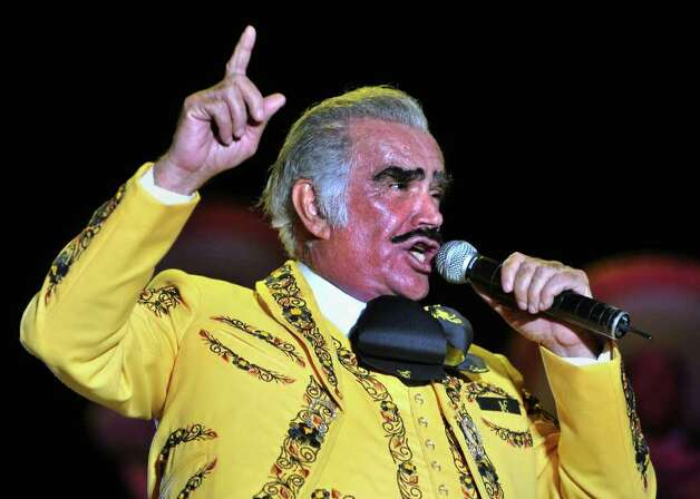 "Mexican singer Vicente Fernandez performs during his concert on February 20, 2009 in Cali, department of Valle del Cauca, Colombia. Fernandez will play in ten cities as part of his ""Para Siempre"" tour 2009. AFP PHOTO/Luis ROBAYO Photo: LUIS ROBAYO, AFP/Getty Images / 2009 AFP"