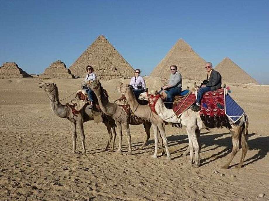 Don Morton, Margo Morton, Jana Beeman, Mike Puzach on camels in Egypt. Photo: Courtesy Photo