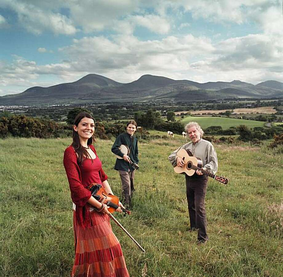 Irish guitarist Tommy Sands (right) and his co-performers: daughter Moya Sands and son Fionan Sands. They will perform at the Plough & Stars in the Richmond District in San Francisco as part of the Crossroads Irish-American Festival on March 2, 2010. Photo: Courtesy Ixtlan Artists Group