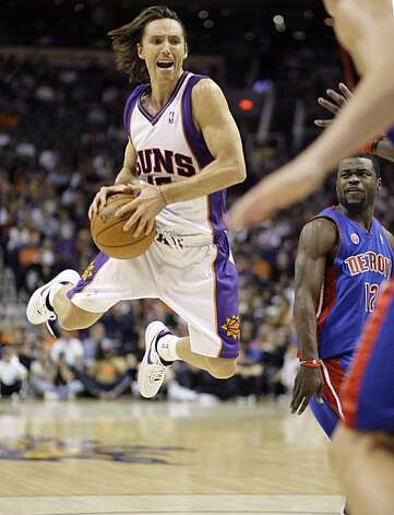 Phoenix Suns guard Steve Nash, left, reacts to being fouled by Detroit Pistons guard Will Bynum, right, during the third quarter of an NBA basketball game Sunday, Nov. 22, 2009, in Phoenix. The Suns won 117-91. (AP Photo/Paul Connors) Photo: Paul Connors, AP