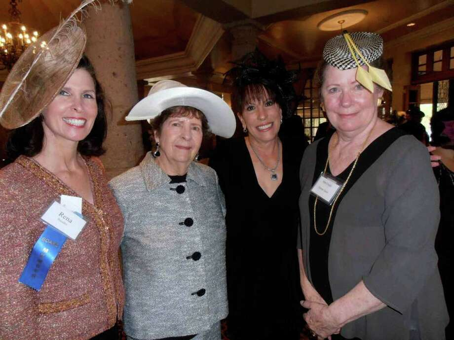 "Rena Baisden, from left, Lauretta Manupelli, president Anne Evans and milliner Rita Crosby share hat notes at the Dominion Women's Forum ""Hats Off"" luncheon. Photo: Nancy Cook-Monroe"