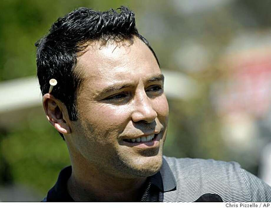 Oscar De La Hoya looks on at the action at the 9th Annual Celebrity Golf Classic hosted by him at Lakeside Golf Club in Burbank, Calif., Monday, Aug. 18, 2008. Photo: Chris Pizzello, AP