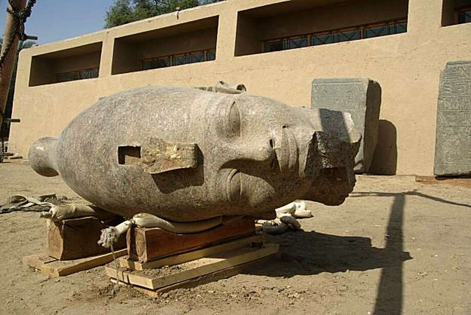 This undated photo released by the Egyptian Supreme Council of Antiquities in Cairo, Egypt, Sunday Feb. 28, 2010, shows the newly unearthed 3,400-year old red granite head, part of a huge statue of the ancient pharaoh Amenhotep III, at the pharaoh's mortuary temple in the city of Luxor. Egypt's Culture Ministry says a team of Egyptian and European archaeologists has unearthed a large head made of red granite of an ancient pharaoh who ruled Egypt some 3,400 years ago. Photo: Supreme Council Of Antiquities, AP