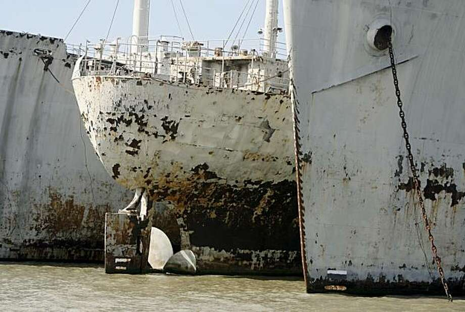 boat tour passes three rusting ships during an inspection of the mothball fleet anchored at the Suisun Bay Reserve Fleet center in Benicia, Calif. on Friday, June 29, 2007. Federal maritime officials say over half of the 74 ships at the site are obsolete and want to scrap them. But several legislators want the entire fleet removed saying it poses an environmental hazard. Photo: Paul Chinn, 2007, The Chronicle