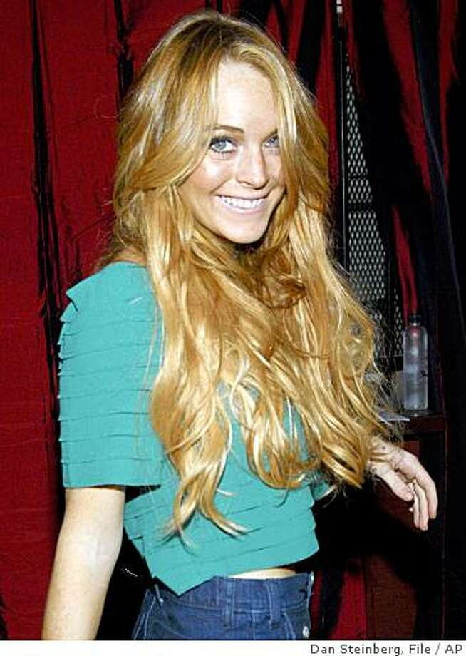 ** FILE ** In this Aug. 14, 2008 file photo, actress Lindsay Lohan poses on the press line at the Apple Lounge grand opening in West Hollywood, Calif. Photo: Dan Steinberg, File, AP