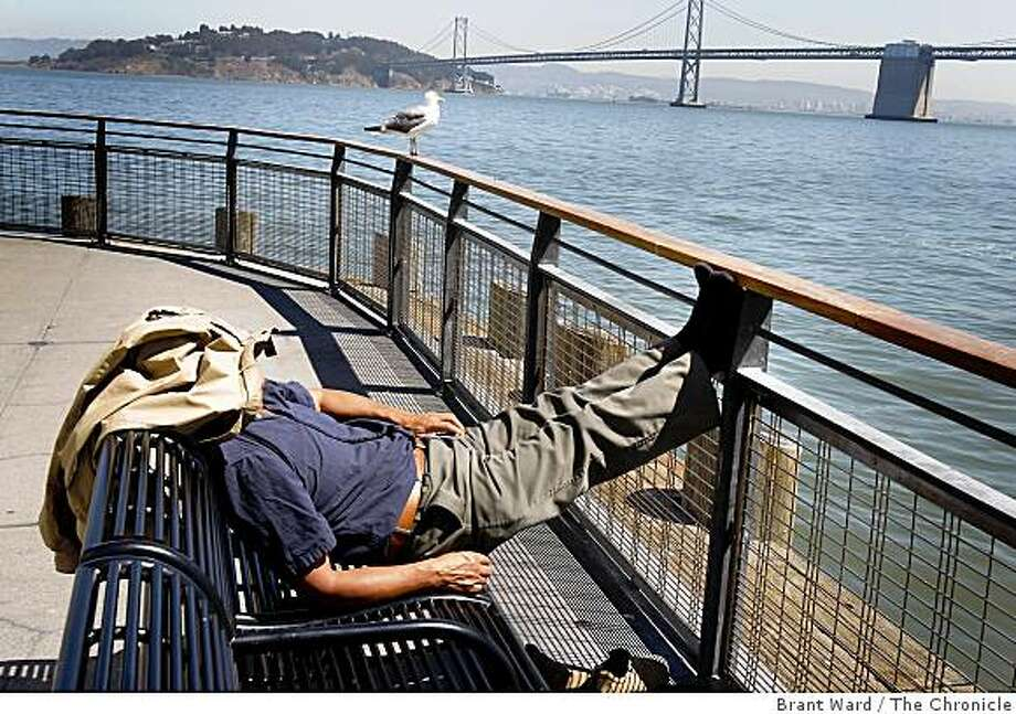 Sitting on the dock of the San Francisco bay was one of the few places in the Bay Area to get some relief from triple digit temperatures as this man discovered Thursday August 28, 2008. Photo: Brant Ward, The Chronicle