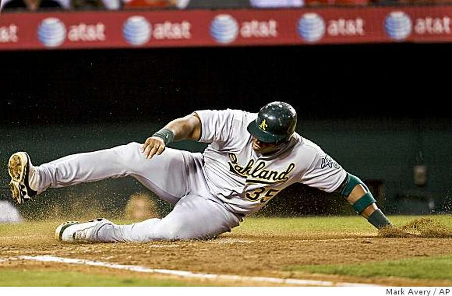 Oakland Athletics' Frank Thomas slides safely into home plate in the fourth inning of a baseball game against the Los Angeles Angels in Anaheim, Calif., Monday, Aug. 25, 2008. (AP Photo/Mark Avery) Photo: Mark Avery, AP