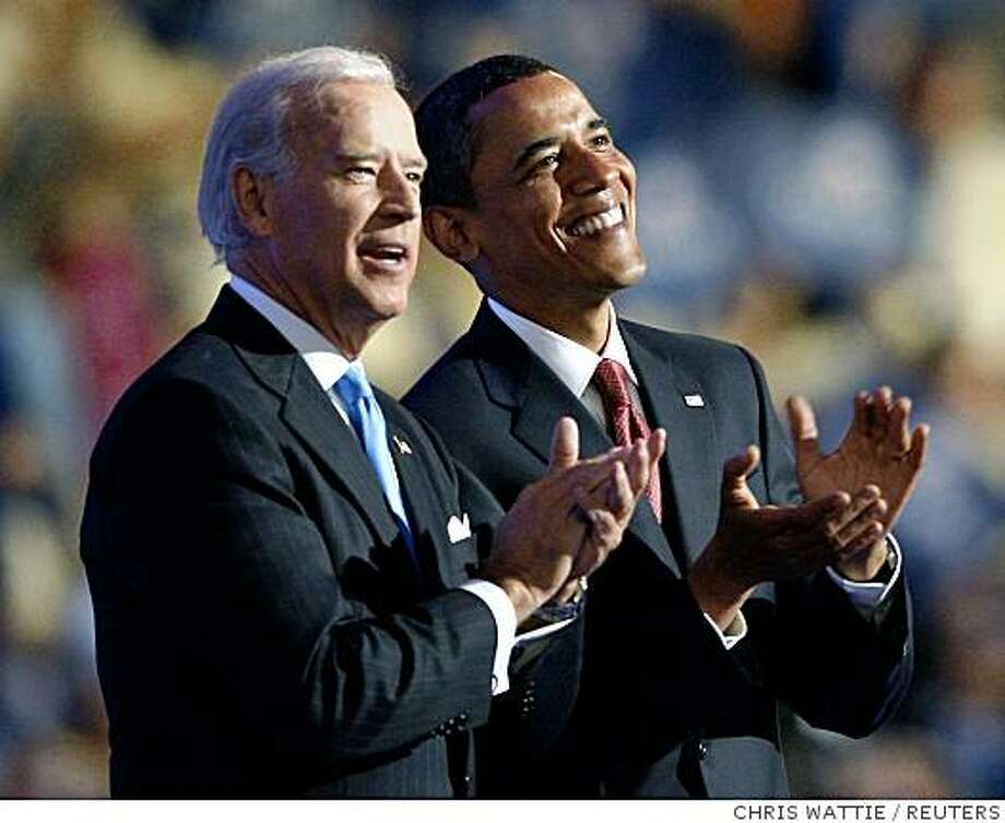 Presidential candidate U.S. Senator Barack Obama (D-IL) (R) and Vice Presidential candidate U.S. Senator Joe Biden (D-DE) applaud on stage at the 2008 Democratic National Convention in Denver, Colorado August 27, 2008. Democrats nominated Senator Barack Obama (D-IL) on Wednesday as their presidential candidate in a historic first for a black American, sending him into battle against Republican John McCain.  REUTERS/Chris Wattie            (UNITED STATES)   US PRESIDENTIAL ELECTION CAMPAIGN 2008  (USA) Photo: CHRIS WATTIE, REUTERS