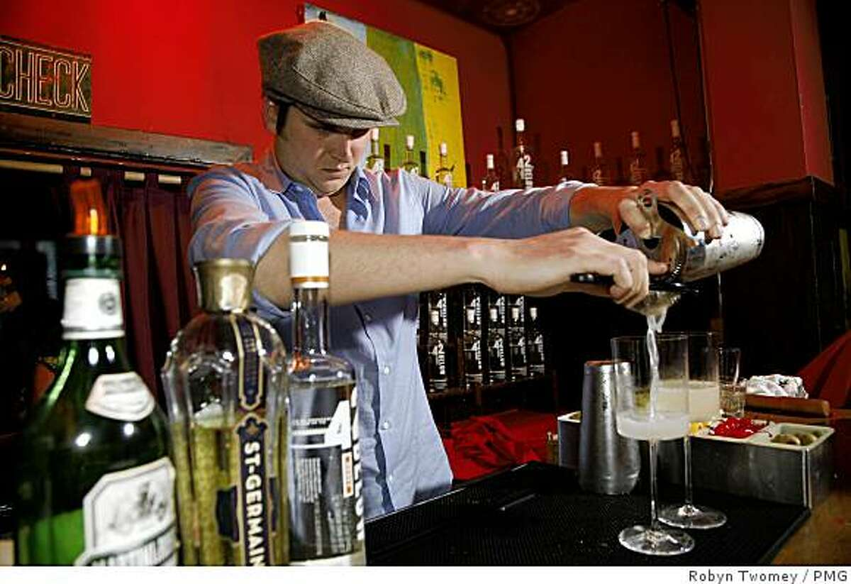 Joel Baker, a bartender from Bourbon & Branch in San Francisco, prepares his drink, the Pear Sonata, at a San Francisco competition July 22, 2008, sponsored by 42 Below vodka. Baker won the competition.