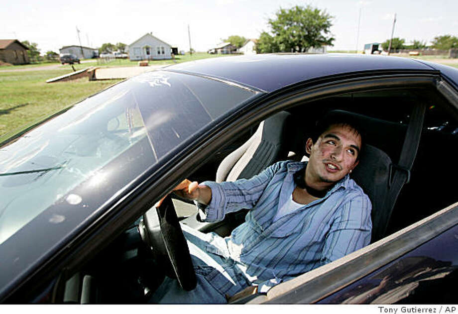 Adam Lira, a senior at Harrold school sits in his car after departing school, Monday, Aug. 25, 2008, in Harold, Texas. Lira said, it felt awkward knowing that some teachers had guns in school but he did not feel threatened by it.  (AP Photo/Tony Gutierrez) Photo: Tony Gutierrez, AP
