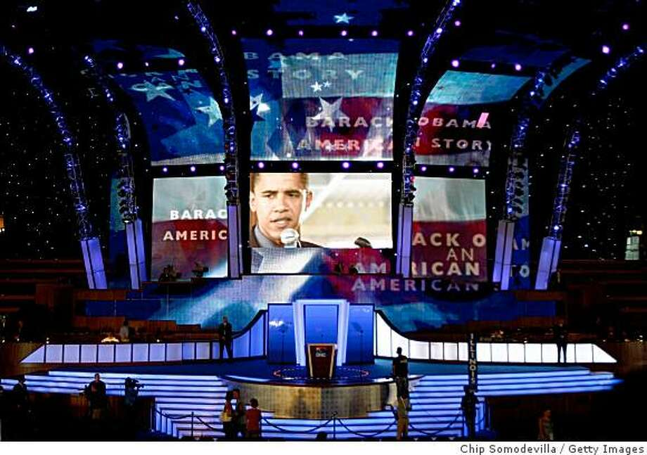 DENVER - AUGUST 24:  An image of Presumptive Democratic presidential nominee U.S. Sen. Barack Obama (D-IL) appears on a screen above the stage at the site of the Democratic National Convention (DNC) at the Pepsi Center August 24, 2008 in Denver, Colorado. The DNC begins August 25 where Obama will be officially nominated as the Democratic nominee for U.S. president.  (Photo by Chip Somodevilla/Getty Images) Photo: Getty Images