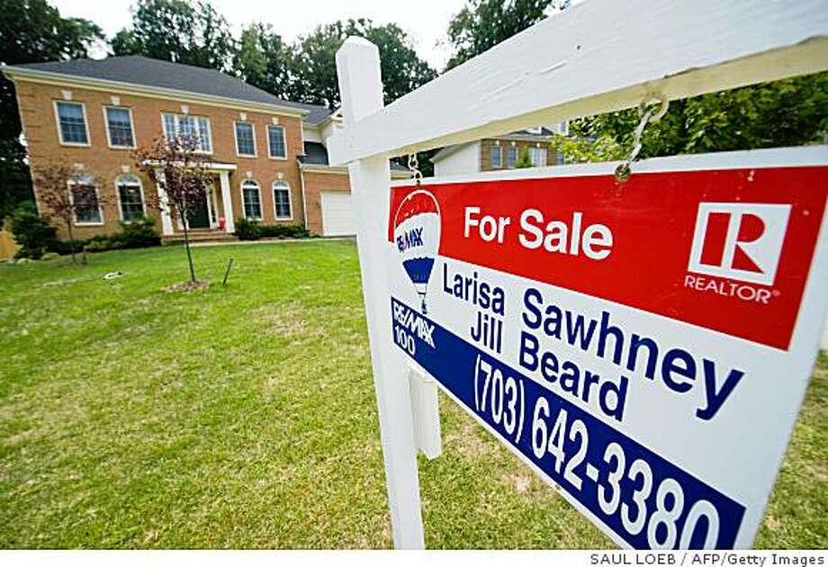 "A ""for sale"" sign sits in front of a home in Alexandria, Virginia, on August 25, 2008. US sales of existing homes rose to a 5-month high in July as the number of homes offered for sale hit a record high, according to a report by the National Association of Realtors (NAR).       AFP PHOTO/Saul LOEB (Photo credit should read SAUL LOEB/AFP/Getty Images) Photo: SAUL LOEB, AFP/Getty Images"