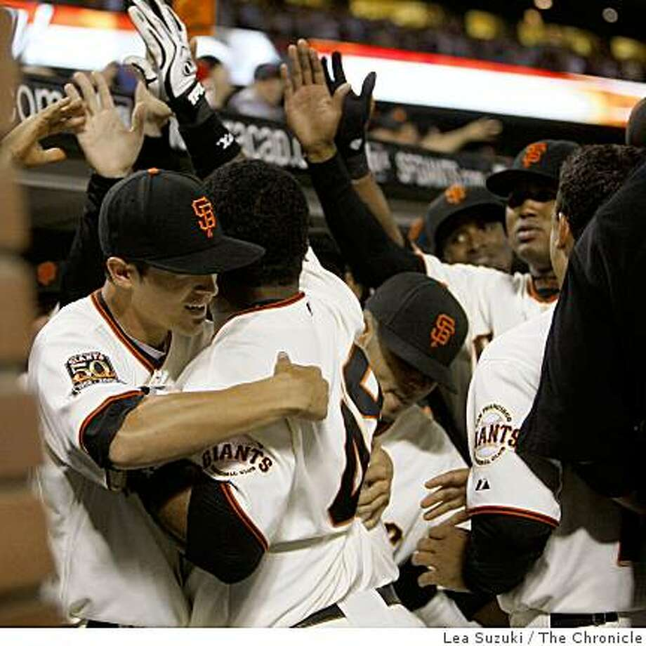 Pablo Sandoval (center #48) celebrates his homerun with teammates in the bottom of the seventh during the San Francisco Giants vs. Colorado Rockies game on Wednesday, August 27, 2008 at AT&T Park in San Francisco, Calif. Photo: Lea Suzuki, The Chronicle