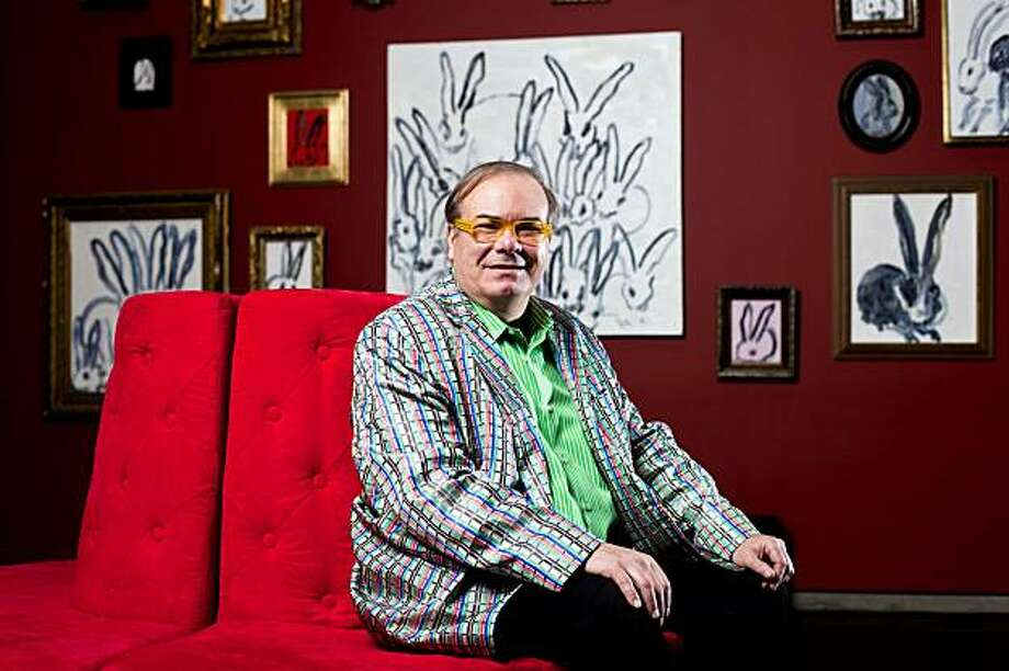 """Painter Hunt Slonem poses for a portrait with his first west coast permanent collection titled """"Flora, Fauna, Faces & Feathers"""" at 12 Gallagher Lane in San Francisco, Calif. on Friday, Jan. 22, 2010. Known for his paintings of whimsical bunnies, famous portraits, colorful birds and an array of flowers, Slonem's work has attracts many well-known art collectors including Sharon Stone, Gina Gershon, Brooke Shields, Julianne Moore, Mandy Moore, Kate Hudson, J.Lo and San Francisco's own Chef Gary Danko. Photo: Stephen Lam, Special To The Chronicle"""